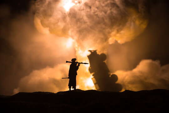 Military soldier silhouette with bazooka. War Concept. Military silhouettes fighting scene on war fog sky background, Soldier Silhouette aiming to the target at night.