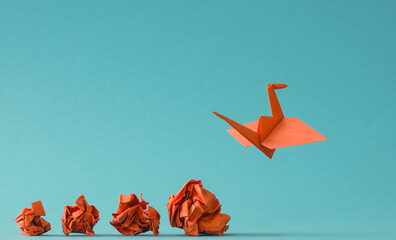 New ideas or transformation concept with crumpled paper balls and a crane, teamwork, creativity, business concept