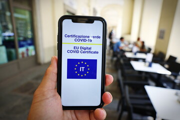 Fototapeta Italian Green Pass. EU Digital certificate Covid-19. Covid or Coronavirus vaccine certificate. Selective focus obraz