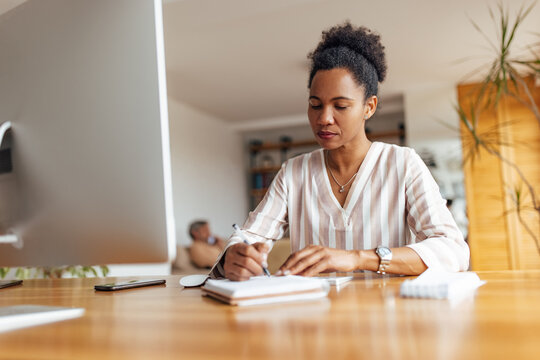Adult woman, writing down her thoughts.