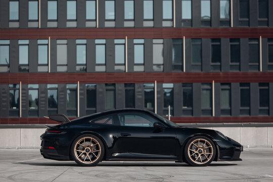 Porsche 911 GT3 2021 at the parking of modern business centre
