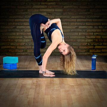 Woman in Yoga Fold Over Tree Pose