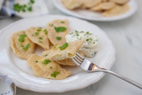Pierogi ruskie, Baked dumplings stuffed with curd cheese and potatoes