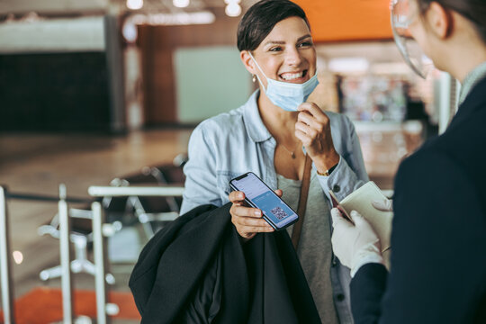 Woman checking in at airport with medical pass
