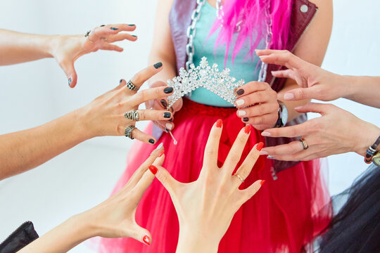 The girls ' hands reach for the crown. Who will be the Queen, the boss or the first beauty. The concept of competition and competition.