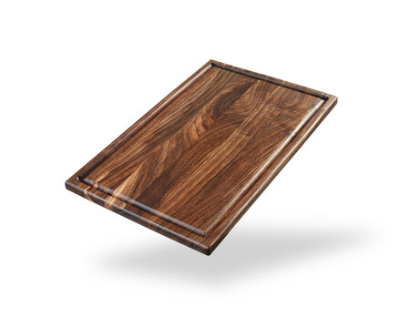 dark wooden cutting board isolated on a white