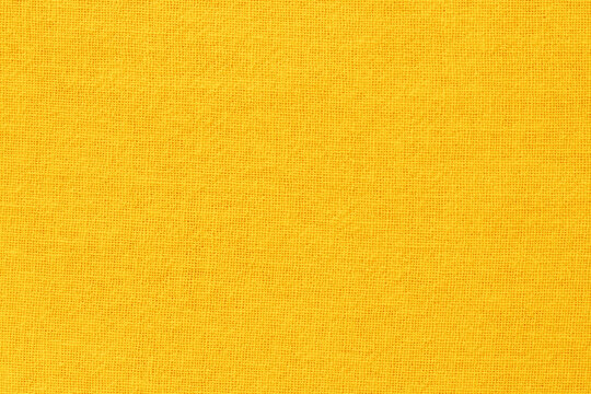 Yellow cotton fabric cloth texture for background, natural textile pattern.