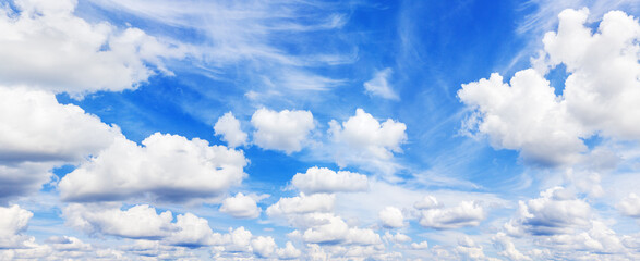 Fototapeta White fluffy clouds clear blue sky background panorama, cumulus cloud texture, cloudy azure skies backdrop, beautiful cloudscape panoramic view, sunny summer day heaven, cloudiness landscape, overcast obraz