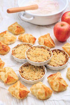 Homemade apple turnovers and small apple crumble cakes