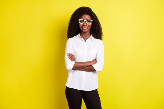 Photo of bossy young intelligent lady crossed arms wear spectacles white shirt isolated on vivid yellow color background