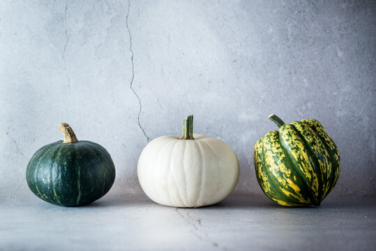 Set of various types of pumpkins on table