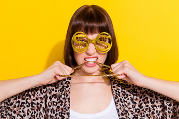 Photo of wealthy young lady bite chain wear eyewear leopard shirt isolated on yellow color background Wall mural