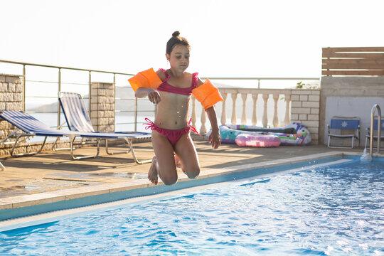 little girl having fun in the pool