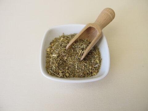 Dried absinthe wormwood herbs on a wooden board, Artemisia absinthium