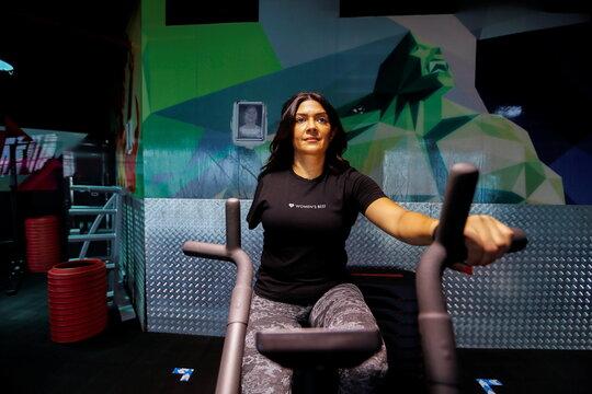 Shaikha al Shaiba, a Bahraini amputee and cancer survivor, exercises at a local gym in Manama