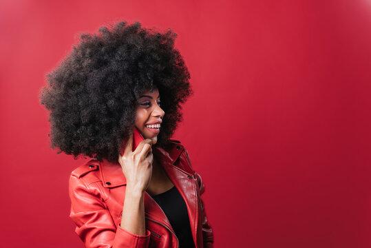 Shocked black woman talking on smartphone