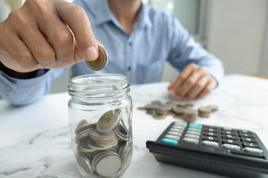Businessman saving money concept.