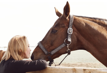 Obraz Girl kissing a horse - rural scene in soft colors - fototapety do salonu