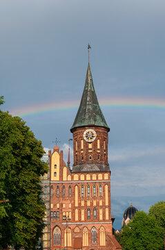 Cathedral of Konigsberg on the Kneiphof island against rainbow, Kaliningrad, Russia