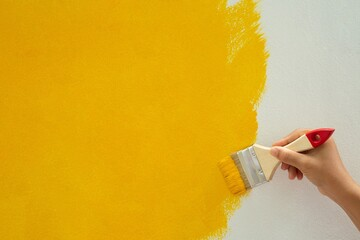 Obraz Do-it-yourself yellow paint plots on the walls of the house - fototapety do salonu