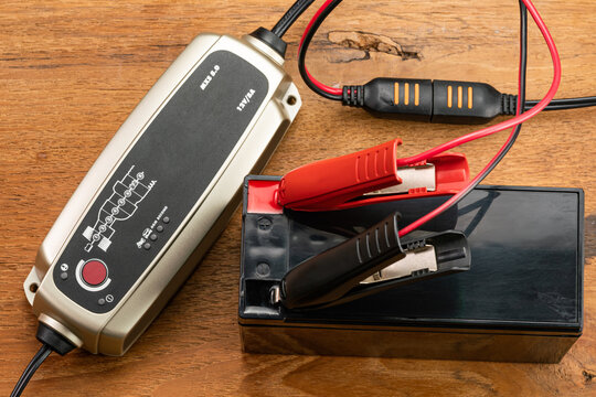 High angle view of battery charger equipment is charging a dry battery.