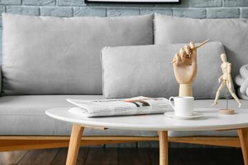 Fototapeta Wooden hand and mannequin on table in living room obraz