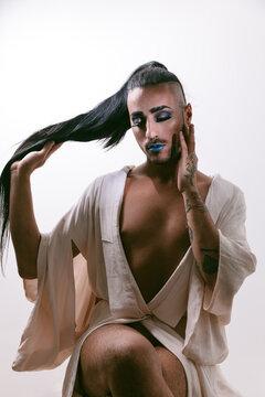 Stylish transgender woman posing at studio