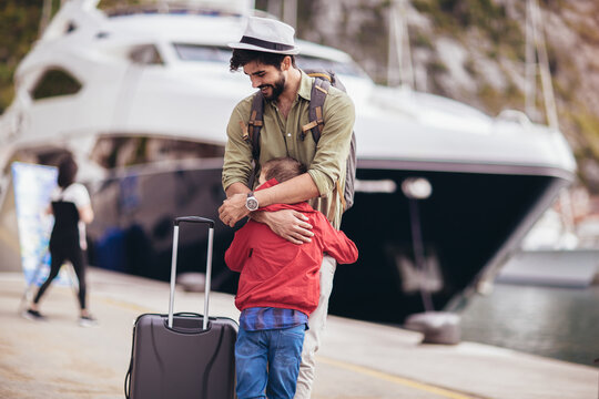 Happy father hugging little son arriving returning after long trip