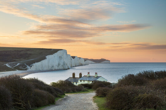 Seven Sisters and Beachy Head with coastguard cottages at sunrise in spring, Seaford Head, East Sussex, England