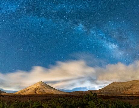 Milky Way in the night sky over Montana del Fronton mountain, La Oliva, Fuerteventura, Canary Islands, Spain