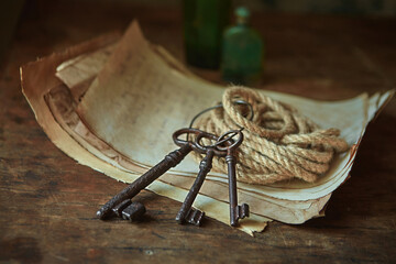 Obraz Antique objects of a treasure hunter, traveler and discoverer - ancient manuscripts, keys to chests. The concept of adventure, prison escape, good luck and romance. - fototapety do salonu