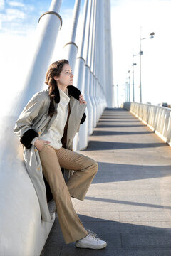 Caucasian woman posing in trench coat and vanishing point with copy space