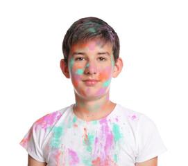 Teenage boy covered with colorful powder dyes on white background. Holi festival celebration