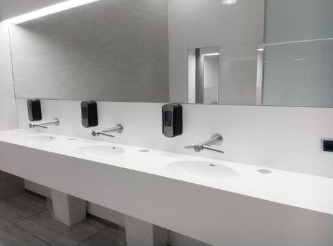 White interior sinks and mirror of public washroom