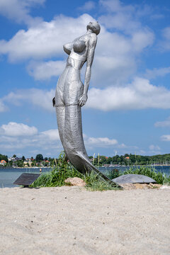 ECKERNFÖRDE, GERMANY - JUNE 20, 2021: mermaid statue at the beach of Eckernförde