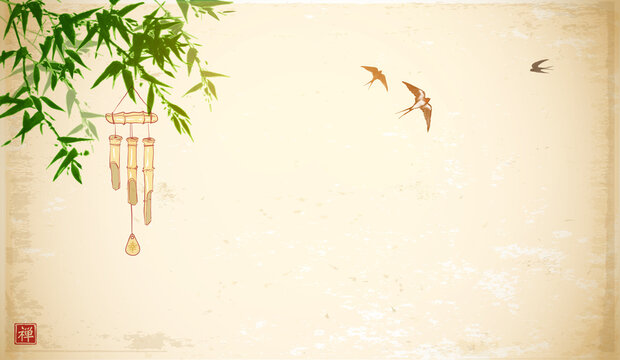 Bamboo wind chime hanging on green bamboo tree and swallows in the sky. Traditional oriental ink painting sumi-e, u-sin, go-hua on vintage background. Hieroglyph - zen