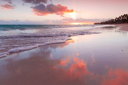 Coastal landscape with colorful sunrise sky, Dominican Republic