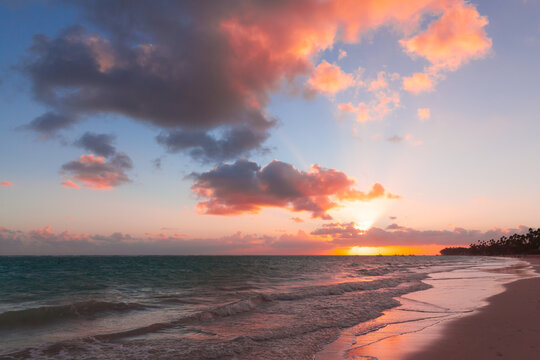Seascape with colorful clouds on a sunrise over Atlantic Ocean