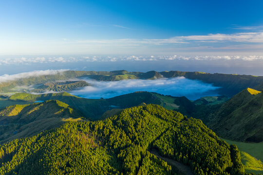 Aerial view of Sao Miguel island landscape at sunset with cloudy sky, Azores Islands, Portugal.