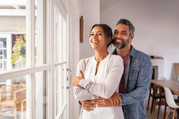 Obraz Mature multiethnic couple thinking about their future family - fototapety do salonu