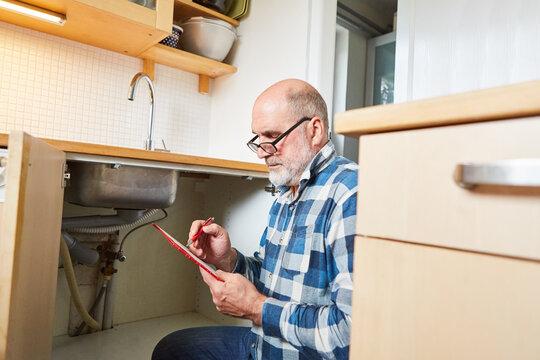 Handyman writes offer on a clipboard
