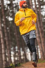 Fototapeta Active man jogging in the park obraz
