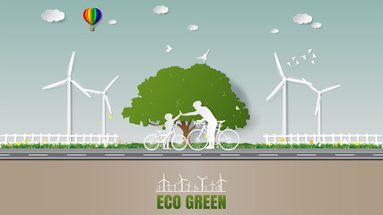 Obraz Paper folding art origami style vector illustration Sustainable green energy ecology concepts, father and son are to join hands together while do activities cycling in park of green meadow - fototapety do salonu