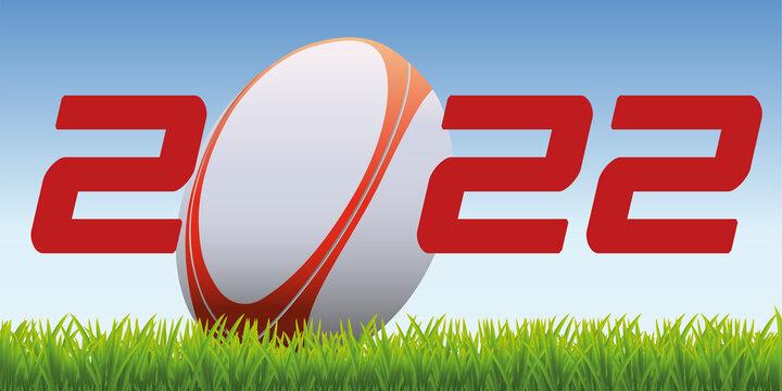 L'année 2022 avec un ballon de rugby posé sur la pelouse d'un terrain pour symboliser le lancement de la nouvelle saison de compétition.