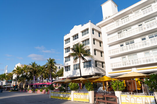 Miami, USA - April 15, 2021: South Beach sidewalk cafes along art-deco hotels at Ocean Drive