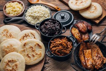 Table served with Venezuelan breakfast, arepas with different types of fillings such as black...