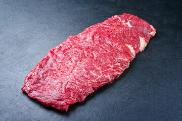 Fototapeta Raw wagyu skirt beef steak offered as close-up on a black board with copy space obraz