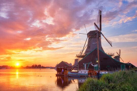 Windmills at Zaanse Schans in Holland on sunset. Zaandam, Nether