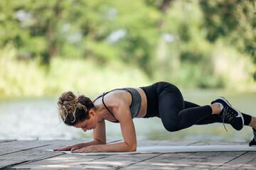 Fototapeta Active woman, making sure she does her exercise correctly. obraz