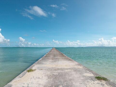 Okinawa,Japan - July 14, 2021: 1000 feet long Iko pier and beautiful sea in Kuroshima island, Okinawa, Japan